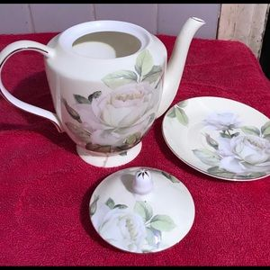 Teapot with lid and saucer